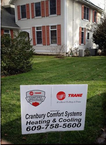 Cranbury Comfort Sign In Front Of This Old House